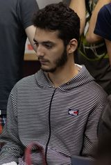 Due to a confusion, now the photo of the Japanese player Red is the following one: https://www.ssbwiki.com/File:Red_(Japan).jpg