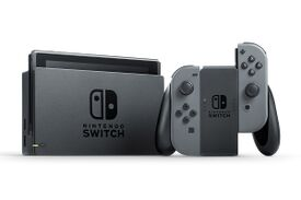 Nintendo Switch console, grey version. Docking station and Joycon shown.