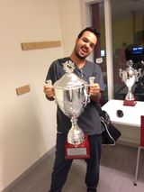 Izaw after winning a tournament. Image is from his Twitter.
